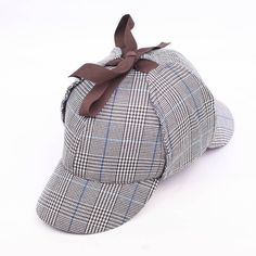Wool tweed deerstalker named after the iconic detective Sherlock Holmes. There are separate front and back peaks and earflaps which can be folded down and tied under the chin. Made of a high quality w