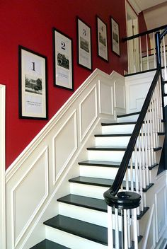 Stairwell, red/white/black.  Art is photos of previous homes.
