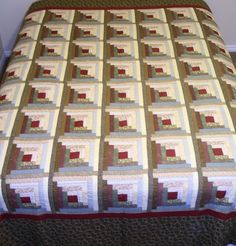King/Queen size log cabin quilt. Heavily hand quilted. Was displayed in the Springville Museum of Art Quilt Show.