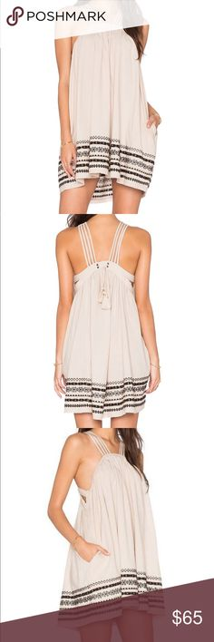 """FREE PEOPLE Batiste Dress FREE PEOPLE Structured Cotton Batiste Kashmir Tent Dress in Biscotti. Size Medium. Brand New with Tags (tag partially cut as shown in photo)  100% Cotton Shoulder seam to hem measures approx 32""""  Lined Multi strap detail Embroidered trim Back tie detail Free People Dresses"""