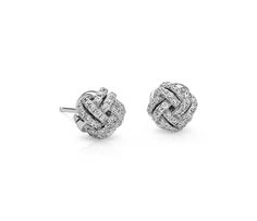 These diamond love knot stud earrings feature round pave-set diamonds intricately set in polished 14k white gold   Valentine's Day Gifts