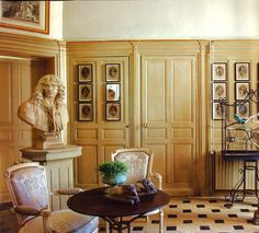 A bust of Moliere overlooks this room