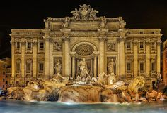This is a three-shot panorama, handstiched. It is very difficult to photograph this fountain without a super wide angle, as the surrounding buildings are very close to the fountain.