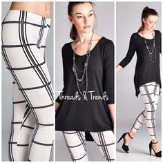"""Black and white Leggings Classic yet edgy black and white leggings in a grid pattern print. Elastic waist, made of poly/spandex blend non sheer. Sizes S, M, L, XL pair with black tunic sold separately. Inseam 28.5"""" Threads & Trends Pants Leggings"""
