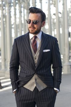 Grey tortoise shades by Matsuda Navy pinstripe suit by Michael Andrews Bespoke (fabric by Ariston) Grey flannel herringbone waistcoat by Mic...