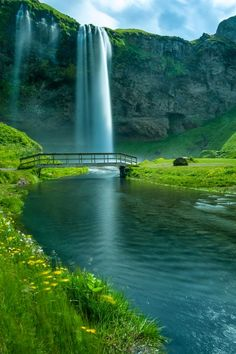 Seljalandsfoss Falls, Iceland - Seljalandsfoss is located between Selfoss and Skogafoss on the Southern Ring Road down to Vik.  This picturesque waterfall plummets two hundred feet to a deep pool below.  Visitors can hike around the pool to the back of the falls.