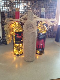 Repurposed wine bottles I made into lights or wrapped with jute and added hand made burlap rose.  Turned out pretty darned nice if I do say so myself!!!