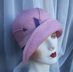 1920's straw cloche hat with ribbon detail.