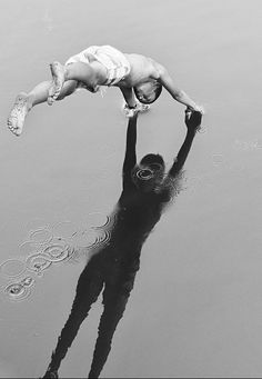 Little boy jumping in the water. Magnificent shadow