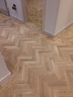 Laid an oak Herringbone parquet floor with a Bona traffic HD Matt finish.