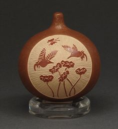 incised hummingbird design in micaceous clay