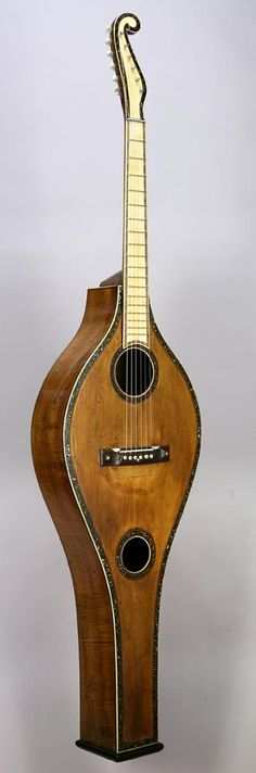 This Scherr-style harp-guitar is actually a rare variation by Boston maker Charles Stumcke, a contemporary of C. F. Martin, & dated 1853