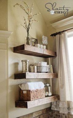 Rustic floating shelves for bathroom storage.