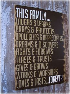 This Family Loves.... Antiqued Plank Typography Sign-Cottage Style. $179.00, via Etsy.