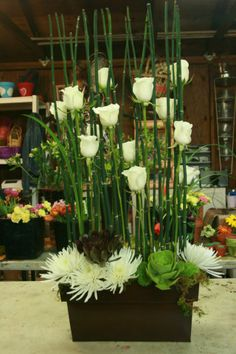 White roses and succulents.  Imagine the possibilities with other colors, too.
