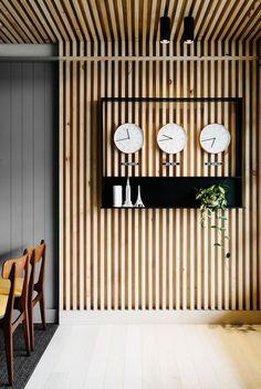 clocks and wood slat panelling @ East Ivanhoe Travel & Cruise reception