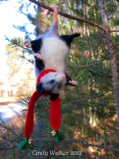 Needle felted baby Christmas opossum!