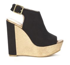 Peep toe shoetie wedge in canvas with adjustable ankle strap and colorblock detail. Brought to you by get taller.