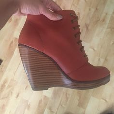 Lace up wedge Orange lace up wedge boot. Worn a few times. Urban Outfitters Shoes Heeled Boots