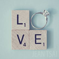 """Round diamond engagement ring with scrabble pieces spelling """"Love"""" in Unique Engagement Ring Shots"""