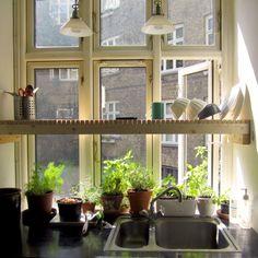 Kitchen Window Garden - over the sink drying rack that passively waters the herbs in pots below