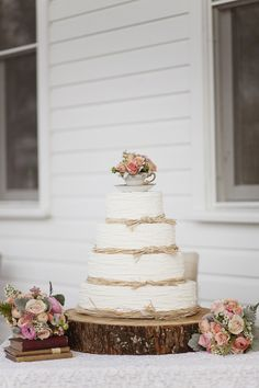 Raffia knotted layers and tea cup topper wedding cake