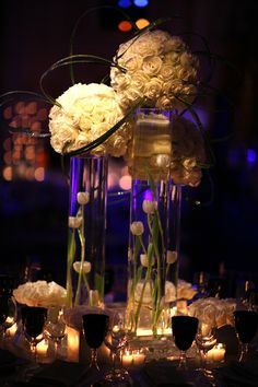 beautiful floral arrangement   candles, flowers, and bent reeds - love.