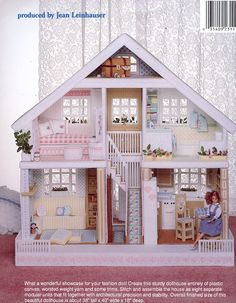 I can't imagine how long this doll house took to make. It is made entirely of plastic canvas and so cute!