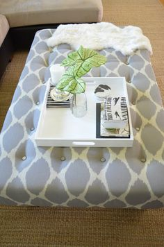DIY Upholstered Ottoman Coffee Table - maybe as a bench seat at the foot of the bed instead?