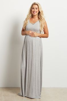 This not so basic sleeveless maternity maxi dress is the ultimate staple piece for your closet this year. A sleeveless top for the warmer weather, and a long maxi skirt for the cooler days. Dress this maternity maxi dress up with a cardigan and statement necklace, or dress it down with sandals or flats for a casual look.