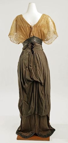 Promenade suit (rear view, without jacket) Callot Soeurs (French, active 1895–1937) Date: ca. 1911 Culture: French Medium: silk, cotton Dimensions: Length at CB (a): 23 3/4 in. (60.3 cm) Length at CB (b): 53 1/2 in. (135.9 cm) Credit Line: Purchase, German Fur Industry Gift, 1982 Accession Number: 1982.369.2a, b