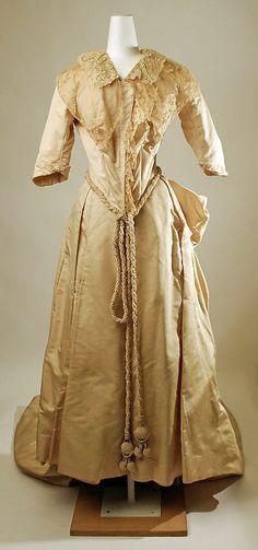 Wedding dress Date: 1887 Culture: American Medium: silk Accession Number: C.I.46.27.1a, b Metropolitan Museum of Art