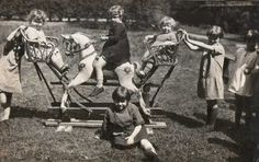 Vintage photo of children playing on rocking horse