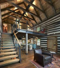Steel I-beams allow for as much clear space beneath the bedroom as possible. The fabricated steel has a rawness that complements the hewn lo...