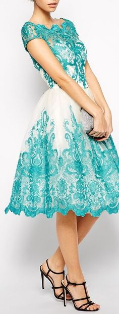 Teal and white lace details.