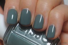 Essie Vested Interest from fall 2013.  A murky greyish teal, it seems much more of a blue-teal in person.  I love this color, I think it's got a lot of depth, really unique and so pretty for fall.  Being less of a girly color, this one will definitely be topped with glitter and done with a girly pink accent nail!