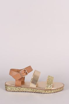 """This chic flat sandal features an open toe silhouette, double band across vamp, sparkling glitter accents, and low flatform heel. Finished with a lightly padded insole and adjustable ankle strap with side buckle fastening. Material: Vegan Leather (man-made) Sole: Rubber Measurement Heel Height: 1"""" w/ 0.75"""" Platform (approx)"""