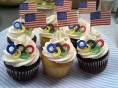 Olympics cupcakes - featuring fondant Olympic rings and american flags…go Team USA!  Submitted by Visions of Sugar Crumbs