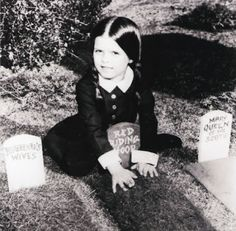 Wednesday Addams playing with her dolls!