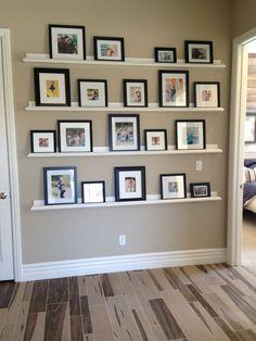 8e91eb8e6c3db7bb05bb6be90220c7c6.jpg 750×1,000 pixels Photo Ledge Display, Picture Frame Shelves, Photo Shelf, Frame Shelf, Shelves On Wall, Diy Picture Frames On The Wall, Picture Wall, Photo Wall, Floating Shelves