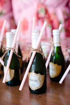 Cute mini champagne bottles with straws for getting ready on the wedding day for your girls! So cute! Would be perfect for a bachelorette party too!
