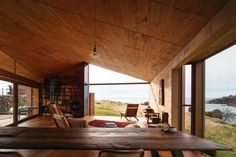 The roof becomes a full gable that opens the view towards the Tasmanian mainland.