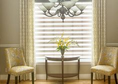 Warm up windows with neutral colored #drapes and light-filtering #sheershades. #BudgetBlindss
