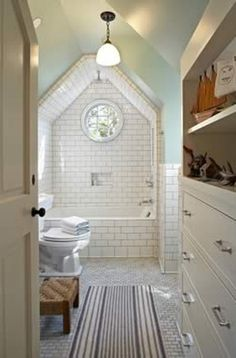 angled shower walls with round window