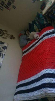 Crocheted Chicago Blackhawks themed blanket