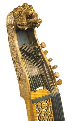 Baryton Germany 1686 Carved pine pegbox, pine top and burr maple sides and back, with gilt and stained tailpiece; carved and pierced maple board running parallel to ivory neck Length 135 cm (total)Length 69 cm (body)Width 42 cm (widest bout) 115 to B, D to Q-1865 Copyright Victoria and Albert Museum