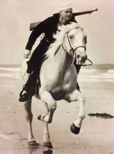 "During WWII, the Coast Guard Beach Patrol covered more than 3,700 miles of coast and employed about 24,000 men. Patrols on horseback worked in pairs, riding about 100 feet apart, usually covering a 2-mile stretch. They were called ""Sand Pounders"" and were able to cover difficult terrain quickly and efficiently. 1945."