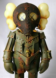 ....emmmm....elephant, crossed with a Steampunk 'Deadmau5'....maybe with a bit of a 'Bioshock' 'Big Daddy' added to the mix...K   PS - NOT suitable for children.    PPS - I better get on with finding some decent 'Bioshock' screen shots....ANOTHER empty promise... Creepy Dolls, Vinyl Figures, Action Figures, Pop Art, Illustration, Vinyl Toys, Vinyl Art, Street Art, Steampunk Robots