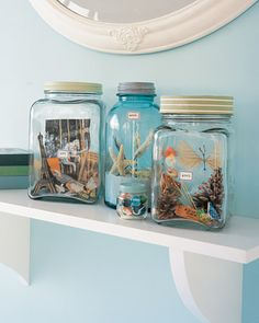 Vacation Memory Jars - how cool for a bookshelf! We always bring home sand, shells, acorns, trinkets, etc from vacation. How fun to have them all contained and on display to re-live!