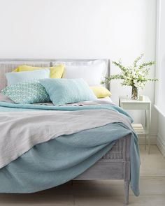 There's nothing more glorious than slipping between smooth, crisp sheets after a hot summer day. So now's the time to take stock of your mattress, lighten your linens, and rethink your bed's layers.